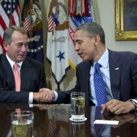 Photo -   President Barack Obama shakes hands with House Speaker John Boehner of Ohio in the Roosevelt Room of the White House in Washington, Friday, Nov. 16, 2012, during a meeting to discuss the deficit and economy. (AP Photo/Carolyn Kaster)