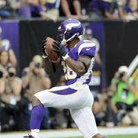 Photo -   Minnesota Vikings running back Adrian Peterson leaps to the end zone as he scores a touchdown during the first half of an NFL football game against the Jacksonville Jaguars, Sunday, Sept. 9, 2012, in Minneapolis. (AP Photo/Jim Mone)