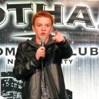 Photo - In this Dec. 16, 2012 photo, teenage comedian Eric Kurn performs his stand-up act during the