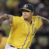 Photo -   Oakland Athletics' Travis Blackley works against the Texas Rangers in the first inning of a baseball game, Tuesday, Oct. 2, 2012, in Oakland, Calif. (AP Photo/Ben Margot)