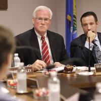 Photo - DHS Commission Chairman Brad Yarbrough, left, and Interim DHS Director Preston Doerflinger listen during a commission meeting Tuesday.   Jim Beckel - THE OKLAHOMAN