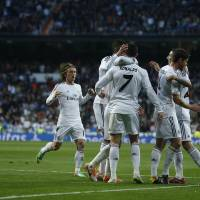 Photo - Real's Cristiano Ronaldo, center, celebrates his goal with teammates during a Spanish La Liga soccer match between Real Madrid and Levante at the Santiago Bernabeu stadium in Madrid, Spain, Sunday March 9, 2014. (AP Photo/Andres Kudacki)