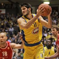 Photo - ** FOR USE AS DESIRED WITH NBA DRAFT STORIES ** FILE - In this Jan. 24, 2008, file photo, Maccabi Tel Aviv's Omri Casspi, center, is seen during a Euroleauge group B basketball match against AJ Milano, in Tel Aviv, Israel. Casspi is a top prospect in the upcoming NBA Draft. (AP Photo/Ariel Schalit, File) ORG XMIT: NY234
