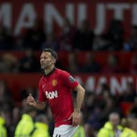 Photo - Manchester United's interim manager Ryan Giggs takes to the pitch as a substitute during his team's English Premier League soccer match against Hull at Old Trafford Stadium, Manchester, England, Tuesday May 6, 2014. (AP Photo / Jon Super)