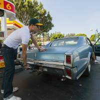 Photo -   Motorist Tony Klein fills up his 1967 Cutlass V-8 at a gas station in Los Angeles Thursday, Oct. 4, 2012. Motorists in California paid an average of $4.232 per gallon Wednesday. That's 45 cents higher than the national average and exceeded only by Hawaii among the 50 states. (AP Photo/Damian Dovarganes)