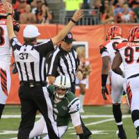 Photo -   New York Jets quarterback Mark Sanchez (6) gets up after being sacked in the first half of an NFL preseason football game against the Cincinnati Bengals, Friday, Aug. 10, 2012, in Cincinnati. (AP Photo/Al Behrman)