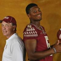 Photo - Florida State head coach Jimbo Fisher, left, and quarterback Jameis Winston (5) pose for a photo during their NCAA college football media day on Sunday, Aug. 10, 2014, in Tallahassee, Fla. Florida State starts its quest for back-to-back national championships Aug. 30 when they open against Oklahoma State in Arlington, Tex. (AP Photo/Phil Sears)