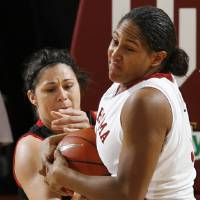 Photo - OU's Ashley Paris (5) and Jordan Murphree (13) of Texas Tech fight for the ball in the first half of the women's college basketball game between Texas Tech and the University of Oklahoma at the Lloyd Noble Center in Norman, Okla., Wednesday, March 4, 2009. BY NATE BILLINGS, THE OKLAHOMAN ORG XMIT: KOD