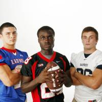 Photo - HIGH SCHOOL FOOTBALL ZONE PREVIEW: From left, Brandon Eddins of Moore, Archie Ocloo-Lee of Westmoore and Andrew Long of Southmoore pose for a photo at the OPUBCO studio in Oklahoma City, Saturday, Aug. 20, 2011. Photo by Nate Billings, The Oklahoman ORG XMIT: KOD