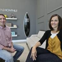 Photo - This photo taken May 2, 2013, shows Sarah Davis and Ben Hemmnger, co-owners of Fashionphile.com, posing in the lobby of their Carlsbad, Calif. office.  The Internet company sells rare, vintage, and discontinued previous owned bags and is facing the complicated task of dealing with new state regulations on Internet sale taxes. (AP photo/Lenny Ignelzi)