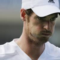 Photo - Andy Murray, of the United Kingdom, reacts after a shot against Jo-Wilfried Tsonga, of France, during the fourth round of the 2014 U.S. Open tennis tournament, Monday, Sept. 1, 2014, in New York. (AP Photo/Charles Krupa)