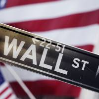 Photo - FILE - This Aug. 9, 2011 file photo shows a Wall Street street sign near the New York Stock Exchange, in New York. U.S. stocks rose Thursday, Sept. 4, 2014, after the European Central Bank surprised traders by trimming its main interest rate to a record low, and announcing that it would purchase asset-backed securities in an effort to stimulate the region's ailing economy.  (AP Photo/Mark Lennihan, File)