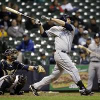 Photo - San Diego Padres' Chase Headley hits a home run during the 12th inning of a baseball game against the Milwaukee Brewers Tuesday, April 22, 2014, in Milwaukee. (AP Photo/Morry Gash)