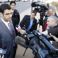 Photo - Muneer  Awad, executive director of Council on American-Islamic Relations in Oklahoma, talks to members of the media outside Federal Courthouse in Oklahoma City, Monday Nov. 8 , 2010 after U.S. District Judge Vicki Miles-LaGrange issued a temporary restraining order blocking a state constitutional amendment that prohibits state courts from considering international or Islamic law when deciding cases. (AP Photo/The Oklahoman, Steve Gooch)
