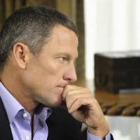 Photo - FILE - In this Monday, Jan. 14, 2013, file photo provided by Harpo Studios Inc., Lance Armstrong listens as he is interviewed by talk show host Oprah Winfrey during taping for the show