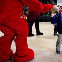 Photo - Ashley Lealos, 3, greets Clifford during a birthday party for Clifford the Big Red Dog on Saturday. Photo by Bryan Terry, The Oklahoman  BRYAN TERRY - THE OKLAHOMAN