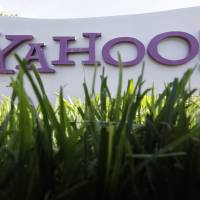 Photo -   FILE - In this May 20, 2012 file photo, a Yahoo sign stands outside the company's offices in Santa Clara, Calif. Yahoo turned in another lackluster performance in the second quarter announce the company on Tuesday, July 17, 2012. The results underscore the challenges facing Yahoo's newly hired CEO Marissa Mayer as she tries to turn around the Internet company after a 13-year career as a top Google executive. (AP Photo/Paul Sakuma, File)
