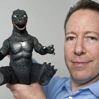 Photo -  In this April 23 photo, entertainment and intellectual property litigation attorney Aaron Moss of Greenberg Glusker shows a licensed, original Godzilla Imperial product at his Century City office in Los Angeles. AP Photo   Damian Dovarganes -