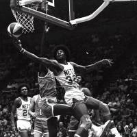 Photo -  Julius Erving hooks in a shot for the New York Nets against the Spirits of St. Louis in an ABA game from December 1975. (AP Photo)