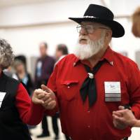 Photo - Angel and Bill Baker dance during a Teacup Chains Square Dance Club open house at Peace Lutheran Church, in Edmond. Photo by Sarah Phipps, The Oklahoman  SARAH PHIPPS