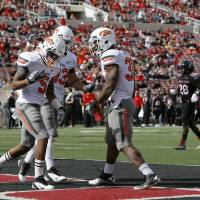 Photo - CELEBRATION: Oklahoma State's Josh Stewart (5) celebrates a touchdown with Colton Chelf (83) and Jeremy Smith (31) during a college football game between Texas Tech University (TTU) and Oklahoma State University (OSU) at Jones AT&T Stadium in Lubbock, Texas, Saturday, Nov. 12, 2011.  Photo by Sarah Phipps, The Oklahoman  ORG XMIT: KOD