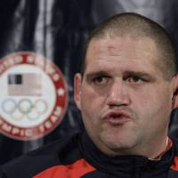Photo - FILE - In this April 21, 2012 file photo, Rulon Gardner speaks during a news conference at the U.S. Olympic Wrestling Team Trials in Iowa City, Iowa. Gardner's epic upset of Russian wrestling great Alexander Karelin in 2000 remains one of the most compelling moments of the modern Olympics. Starting in 2020, youngsters looking to Gardner and Karelin for inspiration won't have a chance to excel on the sport's biggest stage. Gardner and nearly everyone else associated with the sport in the U.S. were jolted Tuesday, Feb. 12, 2013 when International Olympic Committee leaders dropped wrestling from the Summer Games. (AP Photo/Charlie Neibergall, File)