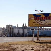 Photo -   This Nov. 27, 2012 photo shows the Sunland Inc. peanut butter and nut processing plant in eastern New Mexico, near Portales, which has been shuttered since late September due to a salmonella outbreak that sickened dozens. The Food and Drug Administration on Monday, Nov. 26, 2012, suspended the registration of Sunland Inc., which is the country's largest organic peanut butter processor. FDA officials found salmonella in numerous locations in Sunland's processing plant after 41 people in 20 states, most of them children, were sickened by peanut butter manufactured at the Portales, N.M., plant and sold at the Trader Joe's grocery chain. The company had announced plans to reopen its peanut processing facility on Tuesday after voluntarily shutting down earlier this fall. (AP Photo/Jeri Clausing)