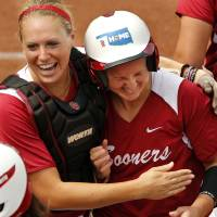 Photo - Jessica Shults, left, hugs Shelby Pendley after one of Pendley's home runs in the NCAA Super Regional softball game as the University of Oklahoma (OU) Sooners defeat Texas A&M 8-0 at Marita Hines Field on Saturday, May 25, 2013 in Norman, Okla. to advance to the College World Series.  Photo by Steve Sisney, The Oklahoman