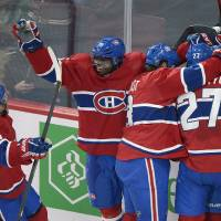Photo - Montreal Canadiens' PK Subban (76), Francis Bouillon (55), Brandon Prust (8), and Alex Galchenyuk (27) celebrate a goal by teammate Brendan Gallagher, hidden, during the second period of  an NHL hockey game against the Buffalo Sabres in Montreal, Saturday ,Feb. 2, 2013. (AP Photo/The Canadian Press, Graham Hughes)