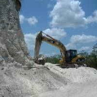 Photo - In this image released by Jaime Awe, head of the Belize Institute of Archaeology on Monday May 13, 2013, a backhoe claws away at the sloping sides of the Nohmul complex, one of Belize's largest Mayan pyramids on May 10, 2013 in northern Belize. A construction company has essentially destroyed one of Belize's largest Mayan pyramids with backhoes and bulldozers to extract crushed rock for a road-building project, authorities announced on Monday. (AP Photo/Jaime Awe)