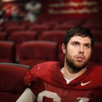 Photo - OU COLLEGE FOOTBALL: University of Oklahoma's Gabe Ikard talks with the media in Norman, Okla., Tuesday, Dec. 20, 2011. Photo by Sarah Phipps, The Oklahoman