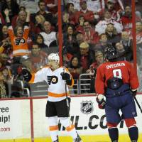 Photo - Philadelphia Flyers defenseman Bruno Gervais (27) celebrates his goal as Washington Capitals left wing Alex Ovechkin (8), of Russia, looks on during the second period of an NHL hockey game on Friday, Feb. 1, 2013, in Washington. (AP Photo/Nick Wass)