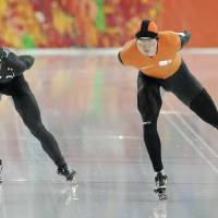 Photo - Jonathan Kuck of the U.S., left, and Sven Kramer of the Netherlands compete in the men's 5,000-meter speedskating race at the Adler Arena Skating Center at the 2014 Winter Olympics in Sochi, Russia, Saturday, Feb. 8, 2014. (AP Photo/Matt Dunham)