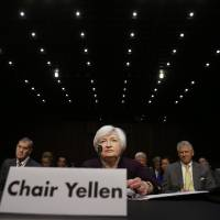 Photo - Federal Reserve Chair Janet Yellen takes her seat before she testifies about the economy at the Joint Economic Committee of Congress on Capitol Hill in Washington, Wednesday, May 7, 2014.(AP Photo/Charles Dharapak)