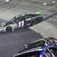 Photo - Driver Denny Hamlin (11) sits on the apron after being wrecked by Kevin Harvick during a NASCAR Sprint Cup Series auto race at Bristol Motor Speedway on Saturday, Aug. 23, 2014, in Bristol, Tenn. (AP Photo/Wade Payne)