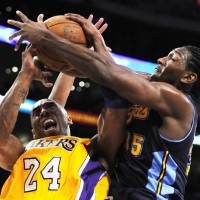 Photo -   Denver Nuggets forward Kenneth Faried, right, ties up Los Angeles Lakers guard Kobe Bryant during the first half in Game 5 of an NBA first-round playoff basketball game, Tuesday, May 8, 2012, in Los Angeles. (AP Photo/Mark J. Terrill)