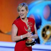 """Photo -   FILE - In this Sept. 18, 2011 file photo, Kate Winslet accepts the award for outstanding lead actress in a mini-series or movie for """"Mildred Pierce"""" at the 63rd Primetime Emmy Awards in Los Angeles. The Academy of Television Arts & Sciences said Thursday, May 31, 2012 that it will merge the leading and supporting acting categories for such longform programming. Starting with the 2013 awards, new categories for outstanding actor in a miniseries or TV movie and outstanding actress in a miniseries or movie will each include six nominees. Previously, the four movie and miniseries acting categories included five nominees. (AP Photo/Mark J. Terrill, file)"""