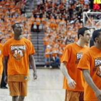 Photo - Texas players warm up wearing