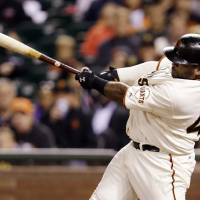 Photo - San Francisco Giants' Pablo Sandoval drives in a run with a single against the Pittsburgh Pirates during the sixth inning of a baseball game on Saturday, Aug. 24, 2013, in San Francisco. (AP Photo/Marcio Jose Sanchez)