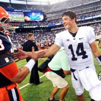 Photo -  Syracuse quarterback Drew Allen, left, talks to Penn State's Christian Hackenberg after the Nittany Lions' win last weekend. Allen transferred from OU. AP PHOTO