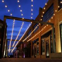 Photo - The former alley between the Guardian Building, 1117 N Robinson Ave. and the Packard Building, 201 NW 10, has been transformed into a lit up courtyard with openings from each building.  Bryan Terry