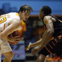 Photo - Oklahoma State's Markel Brown, right, pressures Tennessee's Skylar McBee during a NCAA college basketball game in Bayamon, Puerto Rico, Friday, Nov. 16, 2012. (AP Photo/Ricardo Arduengo) ORG XMIT: SJU105