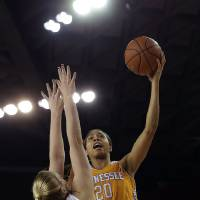 Photo - Tennessee center Isabelle Harrison (20) goes up for a shot against Georgia forward Merritt Hempe (13) in the first half of an NCAA women's college basketball game, Sunday, Jan. 5, 2014, in Athens, Ga. (AP Photo/John Bazemore)