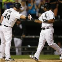 Photo - Chicago White Sox's Dayan Viciedo, right, celebrates his two-run home run against the San Francisco Giants with Adam Dunn, who scored, during the fifth inning of a baseball game on Tuesday, June 17, 2014, in Chicago. (AP Photo/Andrew A. Nelles)