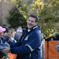 Photo - Mike Golic jokes with Notre Dame fans on the set of ESPN's