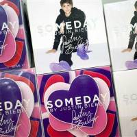 Photo - In this Aug. 23, 2012, photo, Someday fragrance from the Justin Bieber collection is displayed at a Lord & Taylor department store in New York. Celebrities have long dabbled in design, but with the growth of TV shows and websites that follow everything celebrities say, wear and do, interest in their clothing lines has risen in recent years. North America revenue from celebrity clothing lines, excluding merchandise linked to athletes, rose 6 percent last year to an historic peak of $7.58 billion in 2011, according to the latest figures available by The Licensing Letter, an industry trade. That's on top of a nearly 5 percent increase in 2010. (AP Photo/Mark Lennihan)