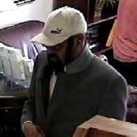 Photo -  Surveillance video from a bank robbery on May 21 at First Fidelity Bank, 10904 N May Avenue, shows a man investigators believe robbed the RCB Bank, 11217 N May Avenue, on Tuesday. PHOTO PROVIDED BY FBI