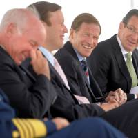Photo - Connecticut Governor Dannel P. Malloy, far right, does some good humored ribbing of Congressman Joe Courtney, left, while Connecticut Senators Chris Murphy and Richard Blumenthal laugh along after Congressman Courtney's late arrival to the ground breaking ceremony for the National Coast Guard Museum at the City Pier Stage on Waterfront Park in New London, Conn., Friday May 2, 2014.  (AP Photo/The Day, Tim Cook)