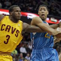 Photo - Cleveland Cavaliers' Dion Waiters (3) fouls New Orleans Hornets' Anthony Davis during the first quarter of an NBA basketball game Wednesday, Feb. 20, 2013, in Cleveland. (AP Photo/Mark Duncan)