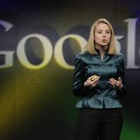 Photo -   FILE- In this Monday, Dec. 7, 2009, file photo, Marissa Mayer, VP of Search Products and User Experience for Google, speaks in Mountain View, Calif. Yahoo announced Monday, July 16, 2012, it is hiring Mayer to be its next CEO, the fifth in five years as the company struggles to rebound from years of financial malaise and internal turmoil. Mayer, who starts at Yahoo Inc. on Tuesday, July 17, 2012, was one of Google's earliest employees and was most recently responsible for its mapping, local and location services. (AP Photo/Marcio Jose Sanchez, File)